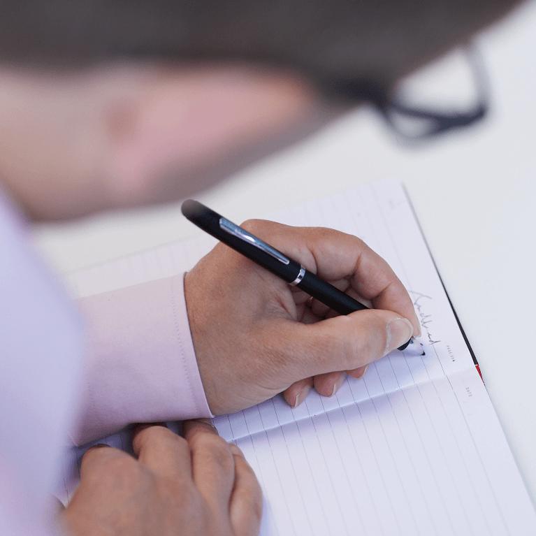 image of employee writing