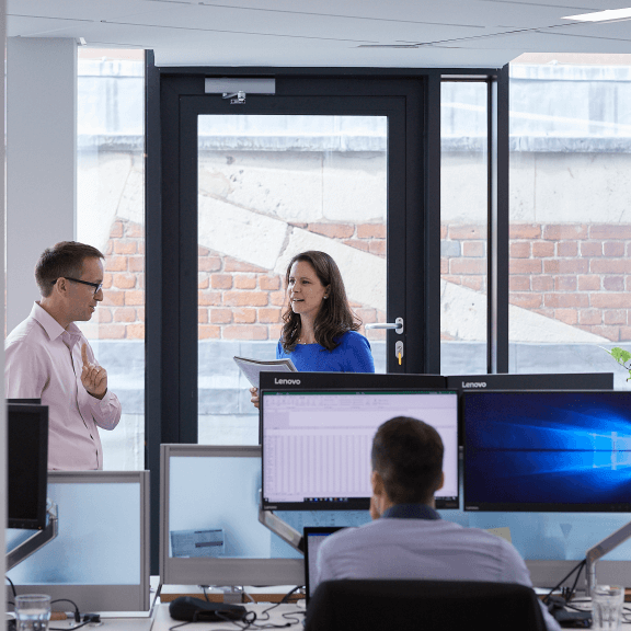 image of employees in the office